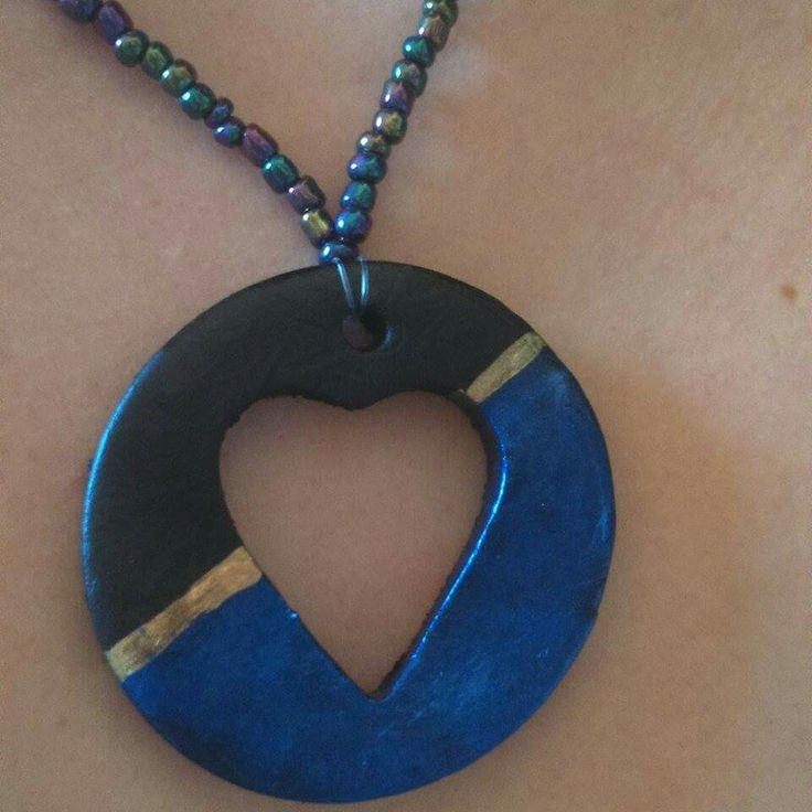 Long necklace.. Clay pendant.