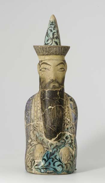 Chess piece Iran, Kashan, made late 13th C. On the brim he is identified as Sultan Tughril and dated 538 AH (1143–44 AD) referring to his reign  The 12th C. historian Ravandi cites Seljuk Sultan Tughril II's prescription for victory on the battlefield: 'Like a chess-player one has to observe the enemy's moves as well as one's own'. Stonepaste ware, painted black under a colourless glaze, partly stained turquoise and cobalt blue.