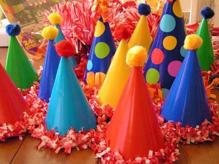 Pom-pom Party Hats There's no birthday party without a party hat – these special pom-pom hats with ruffles are really one of a kind. Andrea ofEveryday Beautybought plain party hats anddecorated them with polka dots, pom-poms and festoning.