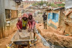 In Kenya there can be really poor or really rich people. People could be eating food out of a trash can or driving a bugatti. The poor people living in slums pretty much live off of the rich people's trash.