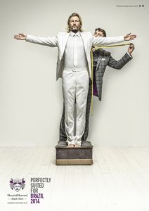 Robbie Savage poses as Christ the Redeemer, the Brazil Statue for World Cup