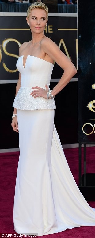 Oscars 2013: Charlize Theron in a Christian Dior Haute Couture dress, Roger Vivier shoes, and Harry Winston jewelry.