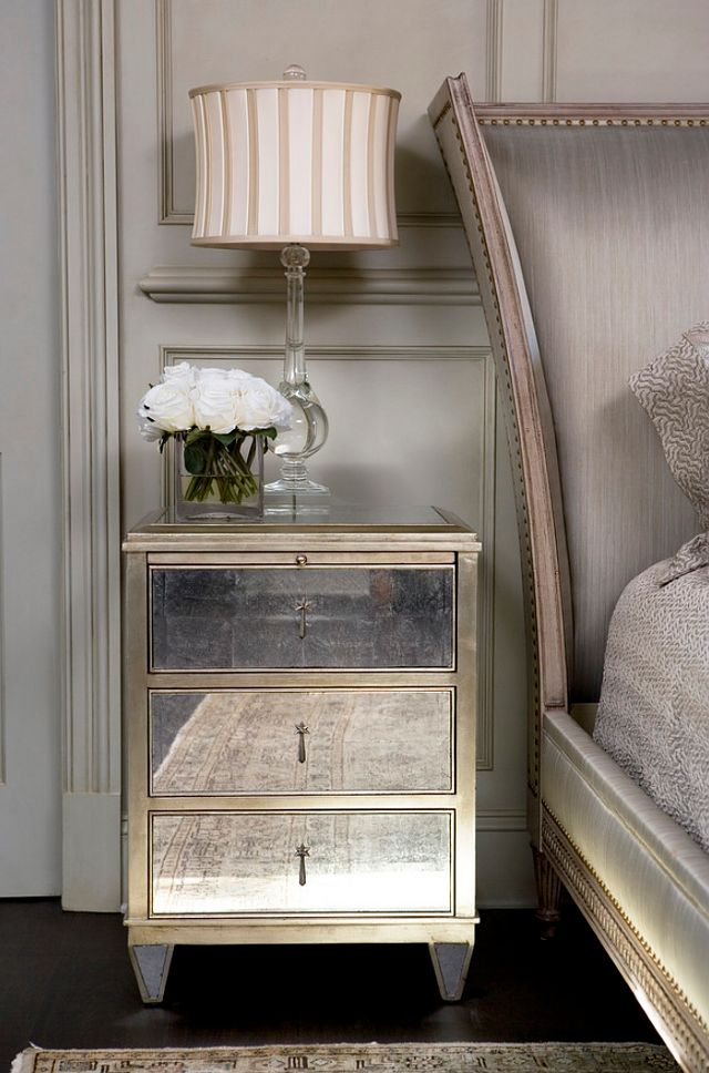 Mirrored bedside table in an elegant gray bedroom | Interior design trends for 2015 #interiordesignideas #trendsdesign For more inspirations: http://www.bykoket.com/inspirations/category/interior-and-decor