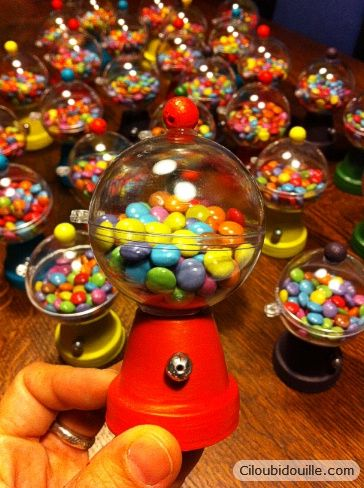 Cute! Made with little clay pots and clear balls.