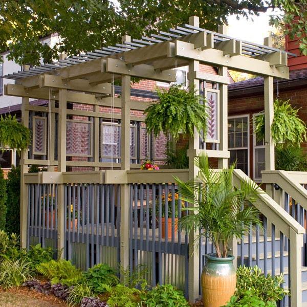 Deck pergola with plant hangers lowe 39 s creative ideas for Diy modern pergola