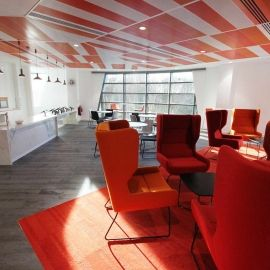 Orange Hush chairs break out space