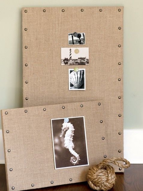 If you already use a framed corkboard and would like to spruce it up, this project is perfect for you. You can pick up some burlap at most garden stores or order this roll of burlap from Amazon.com for a mere $6.50. Score inexpensive metal nailheads for the trim at your local craft supply store. Simply wrap the burlap around the corkboard and, making sure it's very taut, use a staple gun to secure the fabric onto the underside of the wood frame at each of the four corners. Then place staples…