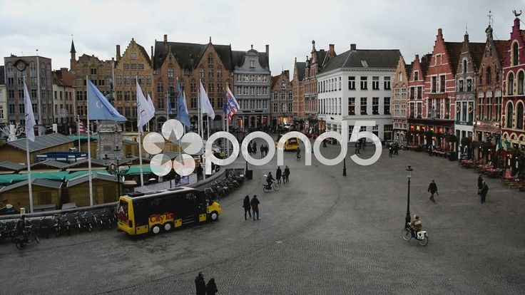 Markt Square Bruges, Belgium. Tour bus, Flags, Xmas market, buildings.With sound - Stock Footage | by glenman77