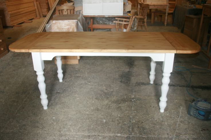 One of our recent extending pine tables:http://www.pinefarmhousetable.co.uk/