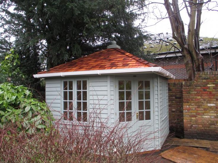 Weybourne Summerhouse with Cedar Shingles Roofing Tiles  A customer of ours in Rochester, Kent designed their own Weybourne Summerhouse to nestle in the corner of their beautifully kept garden.  The summerhouse was coated in Lizard from the Valtti paint system onto the weatherboard cladding. Full details:- https://www.cranegardenbuildings.co.uk/installed-buildings-kent/summerhouse-in-rochester