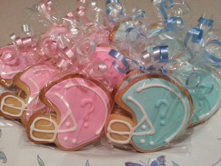 Football themed baby reveal party cookie favors by MerciBeauCookies.blogspot.com