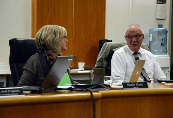 Trustees Heather Maahs and Doug McKay exchange words during a Chilliwack school board meeting Tuesday.