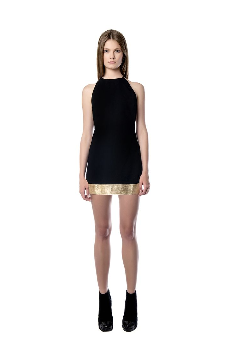 Mini style black dress  A mini – length dress with clear neck line will be the right pick for wearing it after dark. The piece is crafted from black crepe and is finished with glistening fabric. Team yours with tonal accessories.