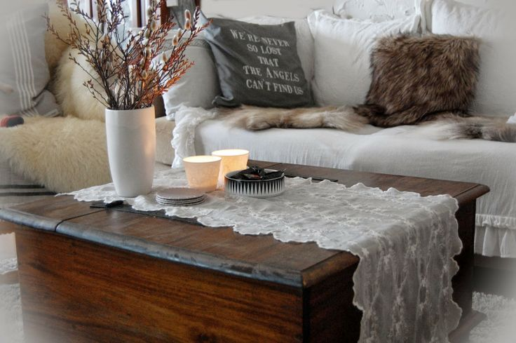 Love the dark wood with dainty white runner over it.