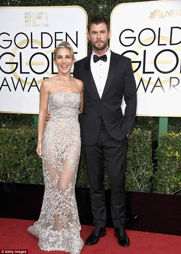 Hot couple! Elsa Pataky and Chris Hemsworth stunned as they made their way along the Golde...