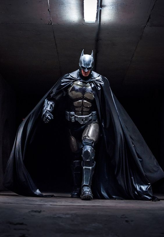 The cosplay we deserve! Master craftsman, Julian Checkley in his Batman cosplay based on the suit worn in Batman: Arkham Origins. Set during a time when Batman was new to the masked vigilante thing, the costume is a heavier suit with more armor plating for a not-so-sure-of-himself hero.: