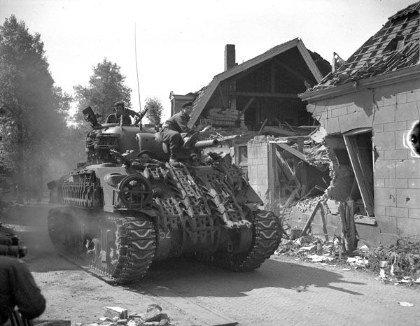 Reenactor Guide Part 2aA Sherman V of 8NBH, 5CAB with surplus Churchill tank track welded to the hull, Putten, Holland, 18Apr45. (LAC, PA131042)