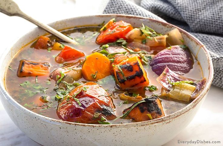 Roasted veggies add intense flavor and sweeten the broth so this roasted vegetable and herb soup will be the best they've ever had!