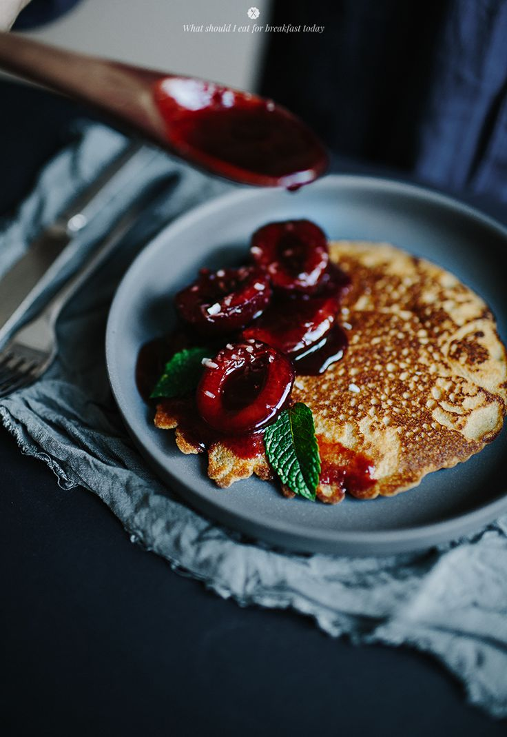Healthy pancakes with plum syrup