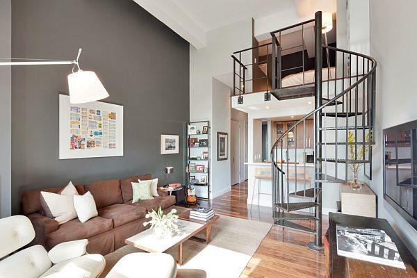 szare ściany,brązowe meble,spiralne szare schody,mały loft