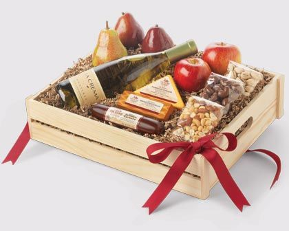 All the farm fresh, savory and sweet flavors they love are packed into this abundant extra-large gift crate. The perfect gift for family and clients. Our Signature Beef Summer Sausage, creamy cheddar cheeses, extra-large Crown Comice® & Red D'Anjou Pears, bright Fuji Apples, crunchy nuts and delectable chocolate-covered cashews, come to life when enjoyed with a bottle of La Crema Chardonnay.