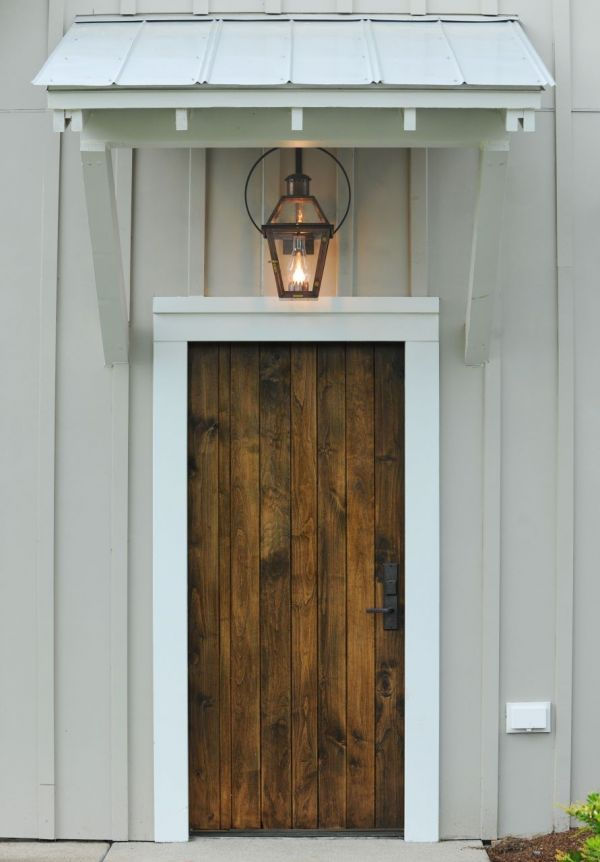 Nice entry to a guest house. Wooden door and French Quarter copper lantern on yoke hanger.