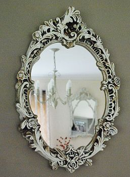 I've bought TWO rococo mirrors from Goodwill that I plan to paint in bold colors…