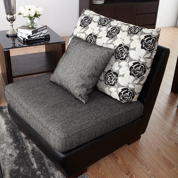 Темно-серое кресло без подлокотников в интерьере комнаты с подушками купить https://lafred.ru/catalog/catalog/detail/44804709343/
