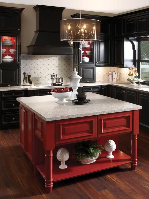 Black cabinetry is hot in a big way, and it infuses a kitchen with a hard-to-duplicate sense of mystery and glamour. But for some, all that darkness can feel heavy and oppressive. Buoy it with a shot of brilliant color, such as the red on this kitchen island. If you have open or glass-front cabinets, you can also use the same brilliant hue to brighten their insides, as seen here.