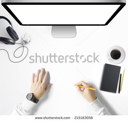 Man drawing on workspace - stock photo