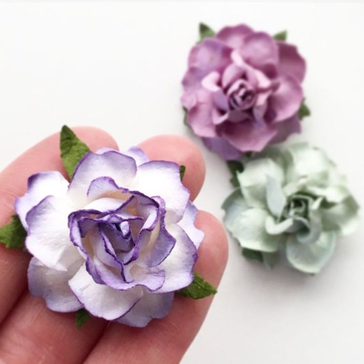 """Irresistible paper flowers measure 1.5"""" across. Made of sturdy card stock paper. Choose from 27 custom colors, mix & match for all of your DIY wedding projects!"""
