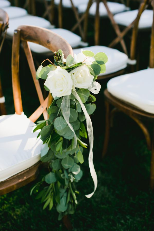 Rustic floral topped ceremony chairs: http://www.stylemepretty.com/california-weddings/napa-valley/2016/01/28/intimate-al-fresco-napa-wedding/ | Photography: OneLove - http://www.onelove-photo.com/