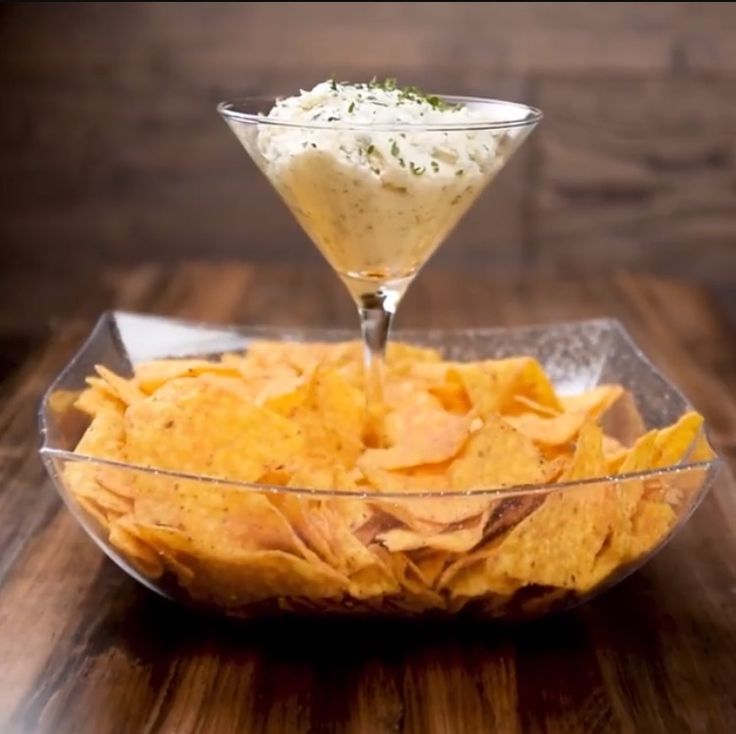 Dollar bowl and dollar martini glass to make chips and dip tray. Smart!!