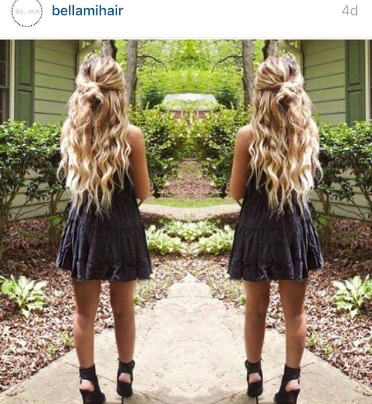 Curly blonde hair with half up/ half down bun