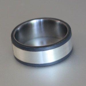 black titanium and silver ring