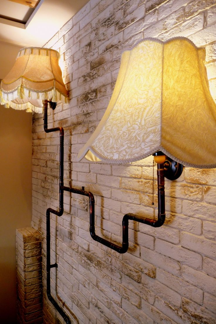 Wall lighting made of waterpipes and half-cut lamp shades | by Nikos Kyriazis