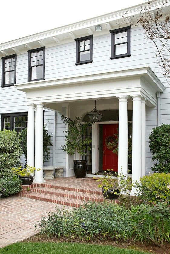 Portico three columns flat roof with simple detailing for Entryway roof designs