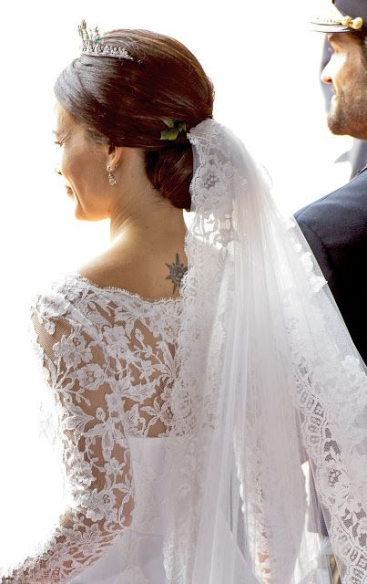The camera catch a rare glimpse of the small tattoo on the back of Princess Sofia's neck