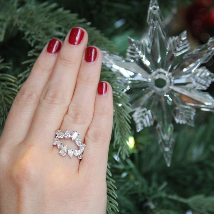 William & Son MYA diamond rings worn stacked to create an oval shape.