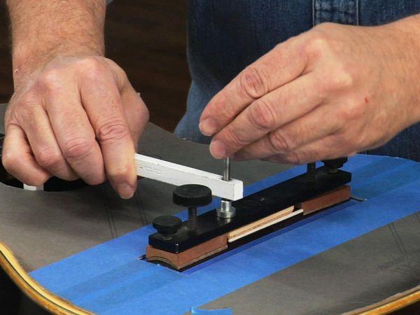 Clamp for installing classical guitar bridge