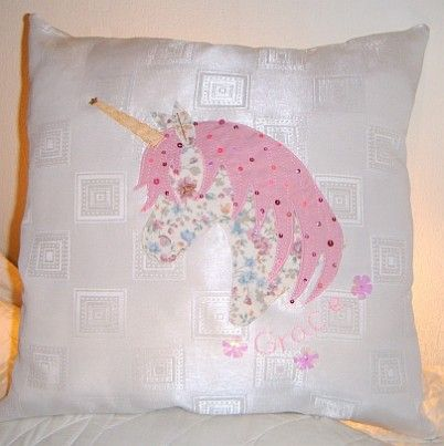 Have your little one's name embroidered here on her very own cushion