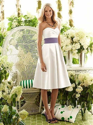 My I'm-refusing-to-get-a-crazy-expensive-dress wedding dress. It's all in ivory. But I'm glamming it up with purple sash and silk flowers my mom is making (GORGEOUS). And I may even get a petticoat, dammit.