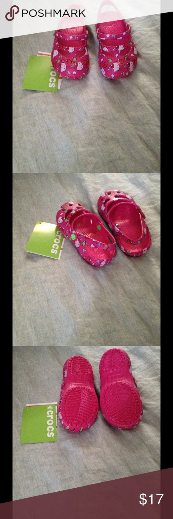 NWT Girls Crocs hello kitty Shayna maryjanes sz 9 Brand new Shayna maryjanes Crocs in Hello Kitty print, toddler girls size 9. Will be posting the dress later - old navy crochet dress sz 4. CROCS Shoes Water Shoes