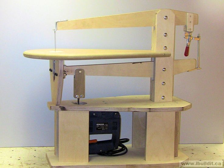 Scroll Saw by Roy -- Homemade scroll saw constructed from Birch plywood, a jigsaw, zero clearance insert, bearings, eyebolts, carriage bolts, and a toggle clamp. http://www.homemadetools.net/homemade-scroll-saw-5