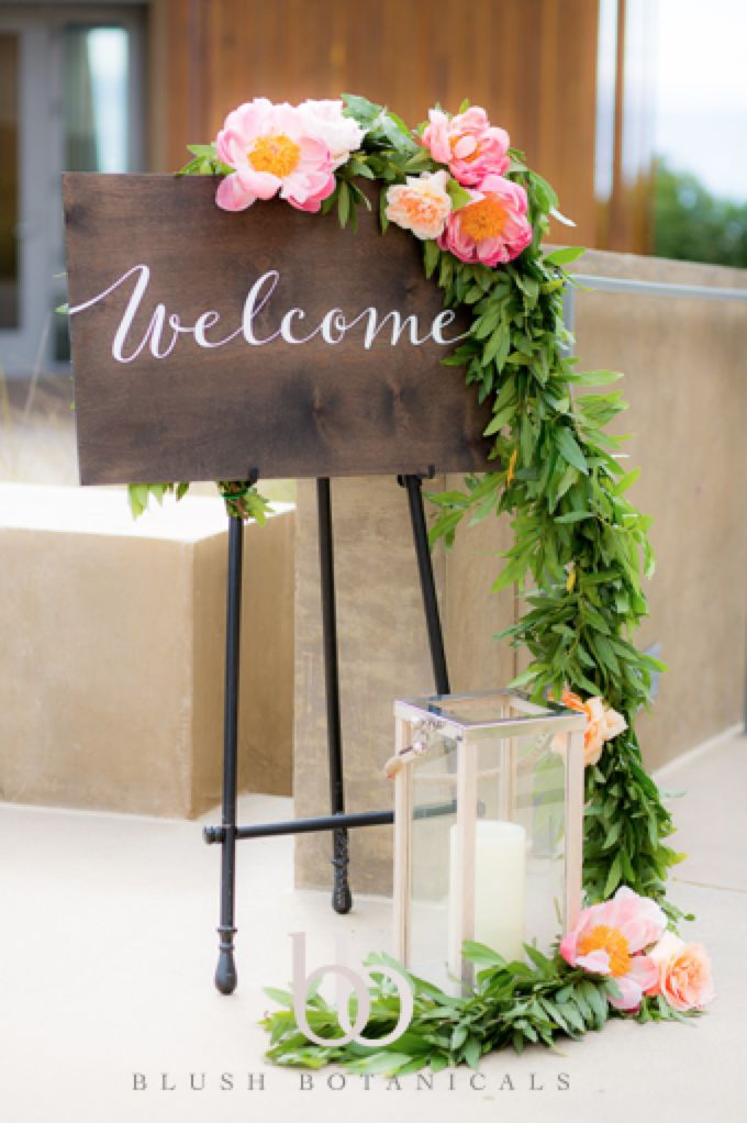 Wedding garland with coral peonies and blush garden roses by Blush Botanicals at the Scripps Seaside Forum.  Photo by The Youngness