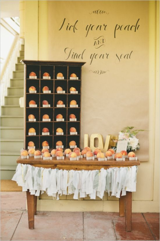 pick your peach escort cards ideas #escortcardtable #weddingideas #weddingchicks http://www.weddingchicks.com/2014/03/21/pretty-peach-wedding/