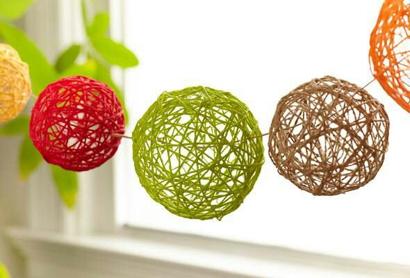 Yarn balls.  Spray balloon with cooking spray, wrap yarn. Coat with mix of starch and white glue.
