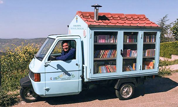 a lovely little mobile library making its way through the italian countryside :)