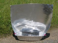 Aluminum Roasting Pan Solar Cooker - Solar Cooking    For back issues and many designs of solar cookers:  http://solarcooking.wikia.com/wiki/Solar_Cooker_Review#Solar_Cooker_Review_.28Archive.29