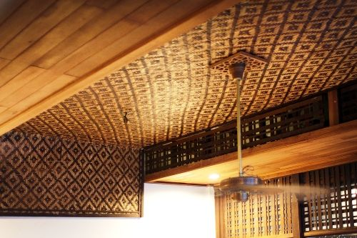 The ceilings in the Malay home isquite unique, sometimes you can see the skeletal beam or a sail of batik patchwork to keep the house lizards dropping from falling on you and also like in this particular photo, a tikar- traditional woven leaves rug.